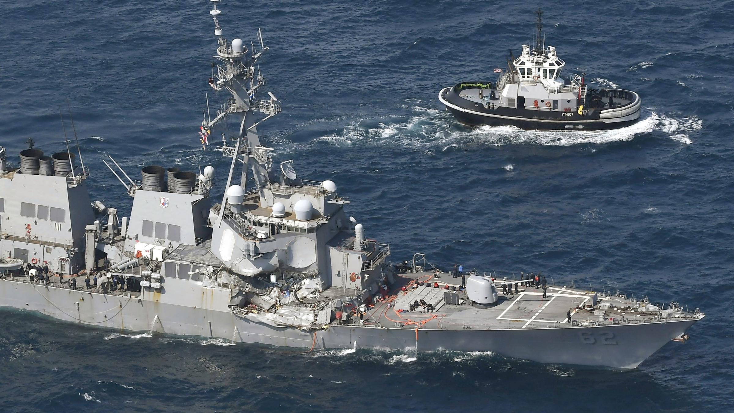 Search for seven sailors after US destroyer damaged in container ship collision